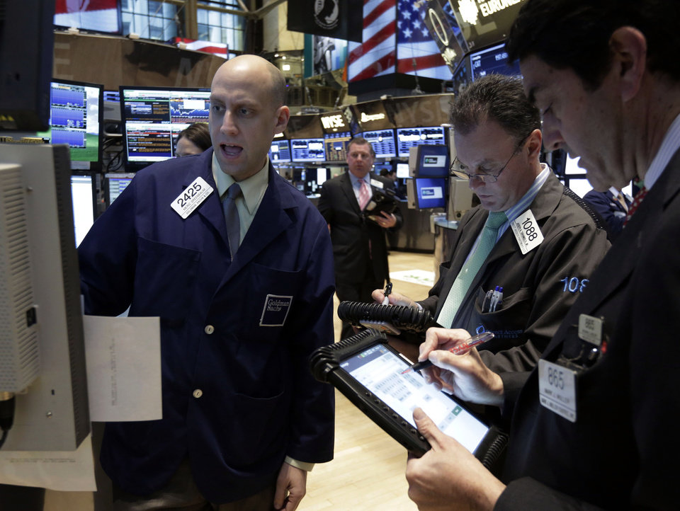 Photo - Specialist Meric Greenbaum, left, works at his post on the floor of the New York Stock Exchange Tuesday, Jan. 29, 2013. Stocks opened mixed on Wall Street, with the Standard & Poor's 500 holding at 1,500. (AP Photo/Richard Drew)
