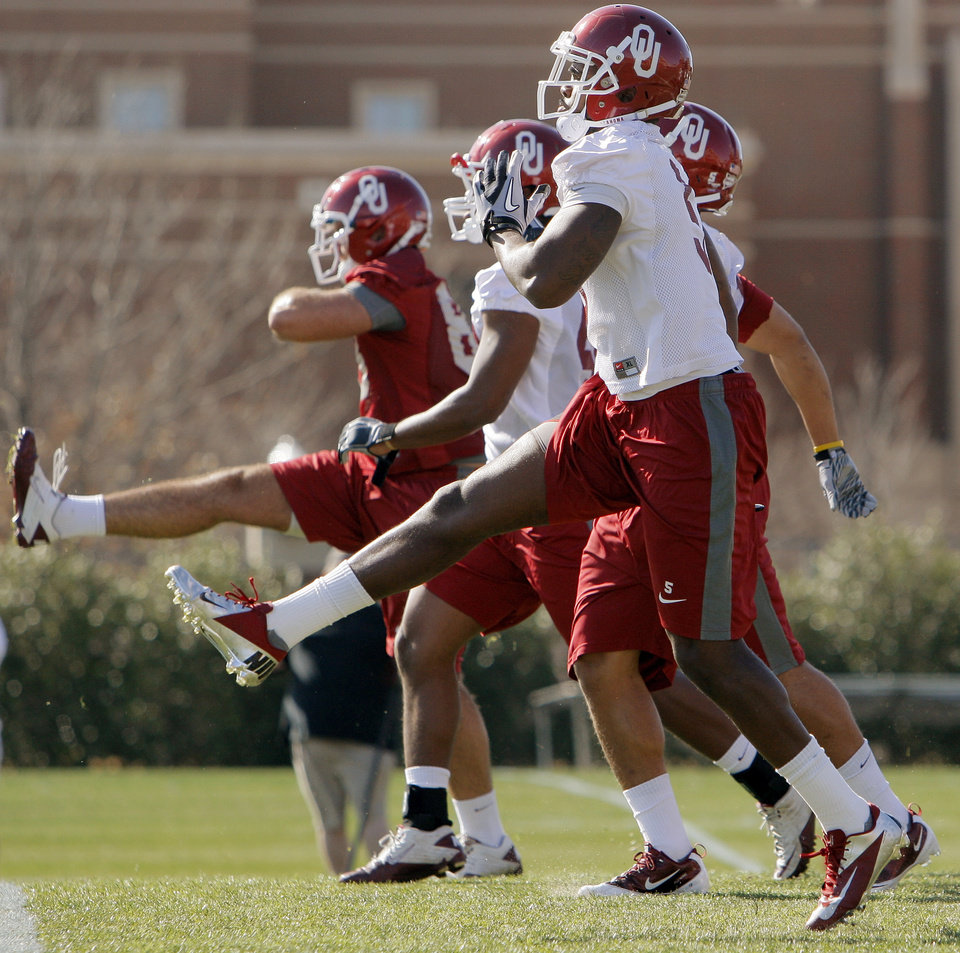 Joseph Ibiloye (5) and other players warm up during spring football practice for the OU Sooners on the campus of the University of Oklahoma in Norman, Okla., Monday, March 5, 2012. Photo by Nate Billings, The Oklahoman
