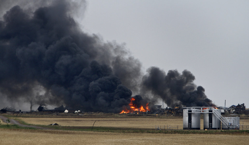 Photo - An industrial yard burns after being hit by a tornado west of El Reno, Tuesday, May 24, 2011. Photo by Chris Landsberger, The Oklahoman ORG XMIT: KOD