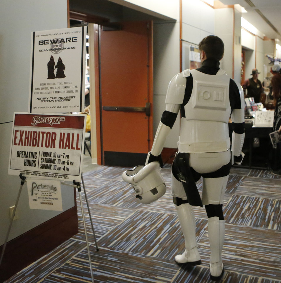 Photo - A storm trooper walks into the exhibitor hall at Soonercon in the Reed Conference Center in Midwest City, Saturday, June 24, 2017. Photo by Jacob Derichsweiler, The Oklahoman
