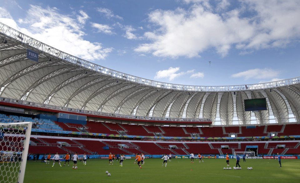 Photo - Netherlands players exercise during the official training the day before the group B World Cup soccer match between Australia and the Netherlands at the Estadio Beira-Rio in Porto Alegre, Brazil, Tuesday, June 17, 2014.  (AP Photo/Michael Sohn)