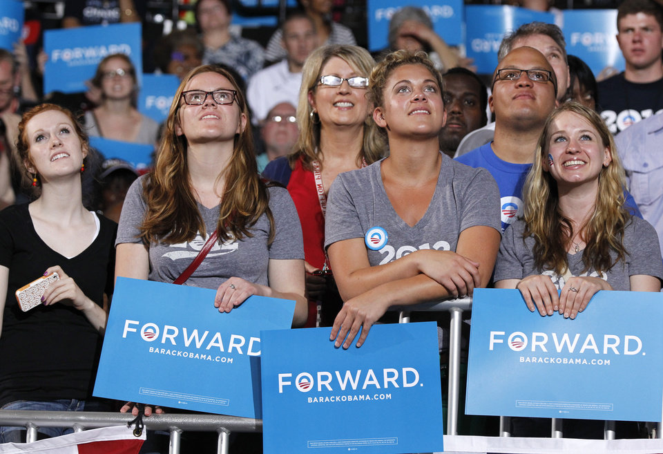 Photo -   People watch a video of President Barack Obama during a campaign rally at The Ohio State University, Saturday, May 5, 2012 in Columbus, Ohio . (AP Photo/Haraz N. Ghanbari)
