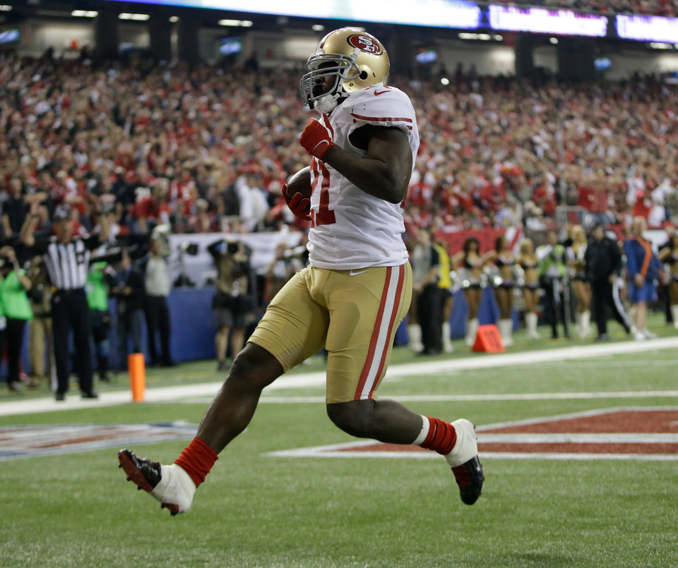 San Francisco 49ers\' Frank Gore breaks away for a five-yard touchdown run during the second half of the NFL football NFC Championship game against the Atlanta Falcons Sunday, Jan. 20, 2013, in Atlanta. (AP Photo/Mark Humphrey)