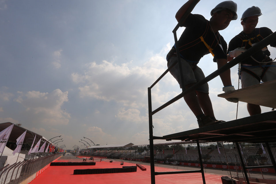 Men work on the Sambadrome, part of the IndyCar's Sao Paulo 300 track, in Sao Paulo, Brazil, Thursday, May 2, 2013.  Brazil will host the 4th race of the Indy Car season on May 5. (AP Photo/Andre Penner)