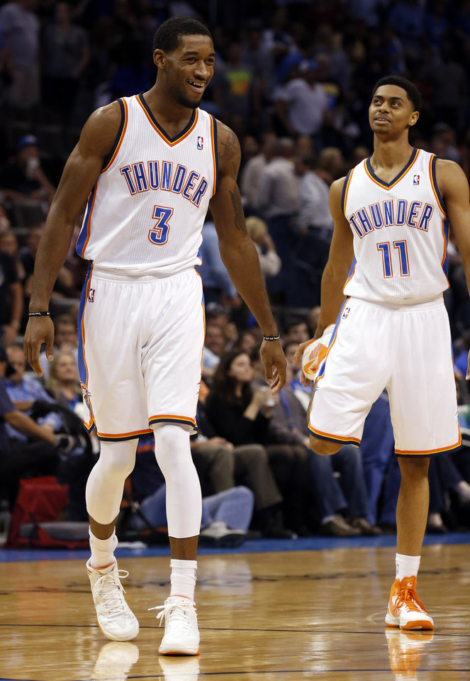 Photo - Oklahoma City Thunder's Perry Jones III (3) and Jeremy Lamb (11) play in the final minutes as the Oklahoma City Thunder defeat the Portland Trail Blazers 106-92 in NBA basketball at the Chesapeake Energy Arena in Oklahoma City, on Friday, Nov. 2, 2012.  Photo by Steve Sisney, The Oklahoman