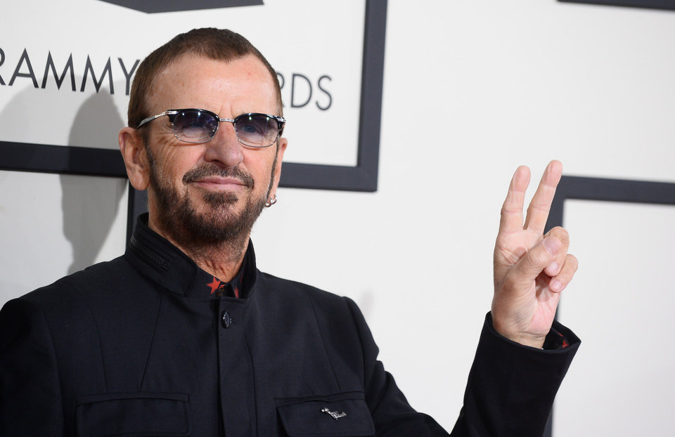 Photo - Ringo Starr arrives at the 56th annual Grammy Awards at Staples Center on Sunday, Jan. 26, 2014, in Los Angeles. (Photo by Jordan Strauss/Invision/AP)