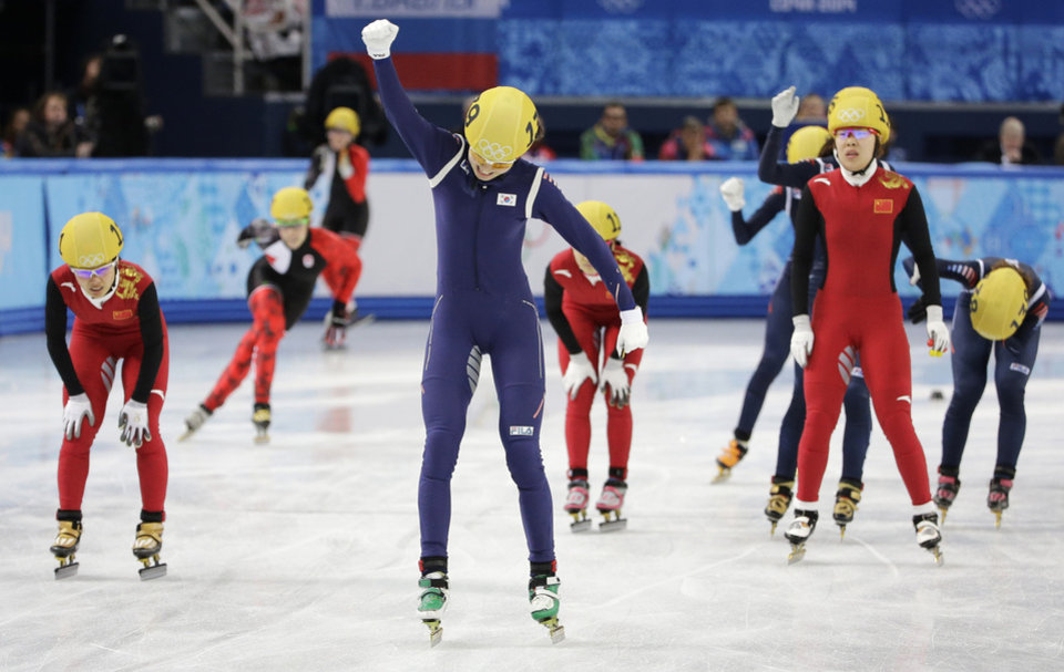 Photo - Shim Suk-Hee of South Korea, center, celebrates her team's first place in the women's 3000m short track speedskating relay final at the Iceberg Skating Palace during the 2014 Winter Olympics, Tuesday, Feb. 18, 2014, in Sochi, Russia. (AP Photo/David J. Phillip, File)