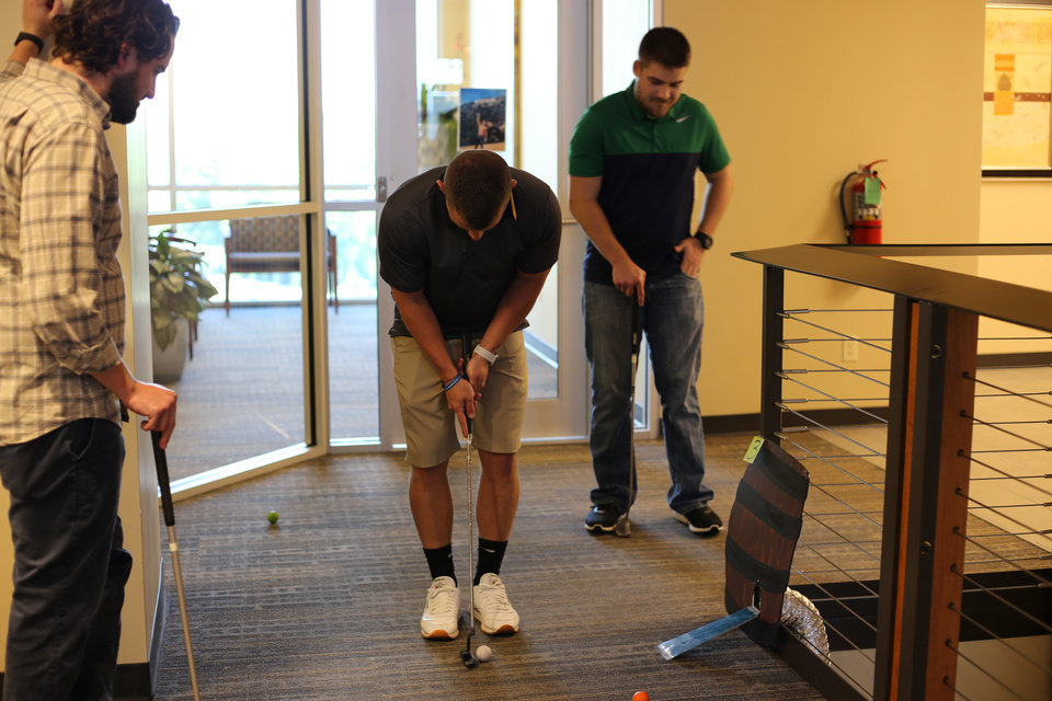 Photo -  Melton fashioned its own putt-putt golf course to benefit the Tulsa Area United Way. [PHOTO PROVIDED]