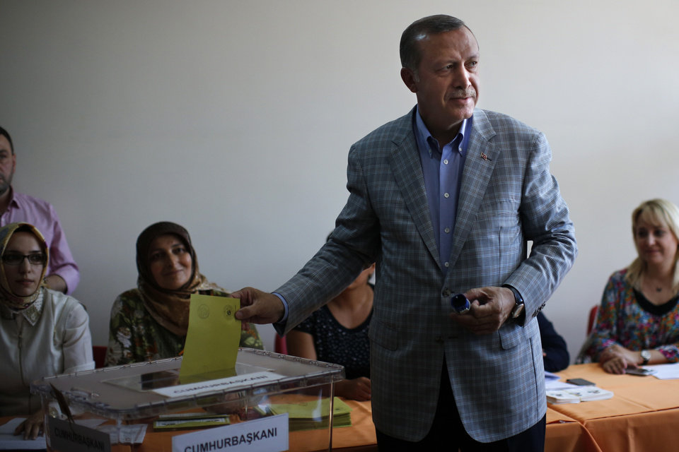 Photo - Prime Minister Recep Tayyip Erdogan, who is the front-runner in Turkey's presidential election, casts his vote at a polling station in Istanbul, Turkey, on Sunday, Aug. 10, 2014. Turks were voting in their first direct presidential election Sunday _ a watershed event in Turkey's 91-year history, where the president was previously elected by Parliament. Prime Minister RecepTayyip Erdogan, who has dominated the country's politics for the past decade, is the strong front-runner to replace the incumbent, Abdullah Gul, for a five-year term. (AP Photo/Emilio Morenatti)