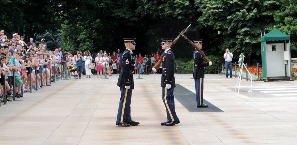 Photo - A wreath-laying ceremony is performed Wednesday at Arlington National Cemetery.  Photo by Bryan Painter, The Oklahoman  Bryan Painter