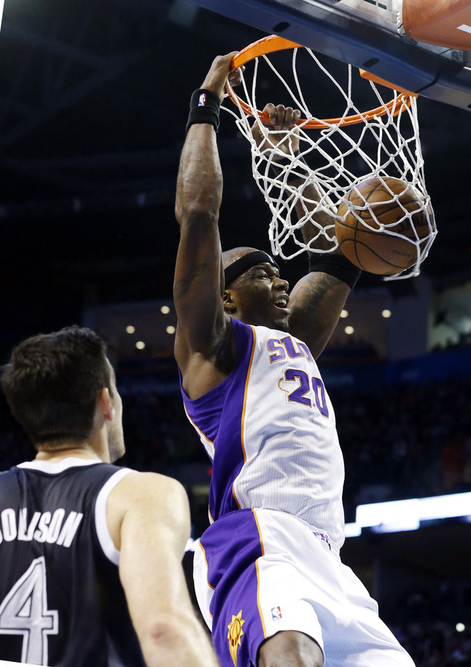 Phoenix Suns center Jermaine O'Neal (20) dunks in front of Oklahoma City Thunder forward Nick Collison (4) in the second quarter of an NBA basketball game in Oklahoma City, Monday, Dec. 31, 2012. (AP Photo/Sue Ogrocki)