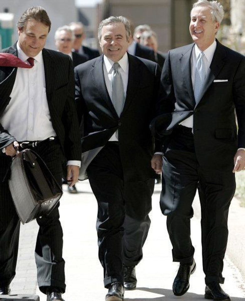 Former Senate leader Mike Morgan, center, walks to his arraignment Wednesday with his attorneys David Ogle, left, and Hal Ellis.  <strong>John Clanton - The Oklahoman</strong>