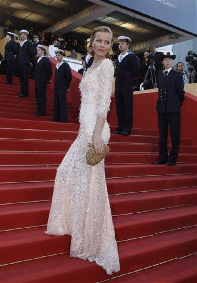 Photo - Model Eva Herzigova arrives for the opening ceremony and screening of Moonrise Kingdom at the 65th international film festival, in Cannes, southern France, Wednesday, May 16, 2012. (AP Photo/Lionel Cironneau)