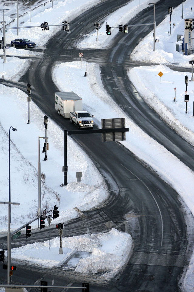 Photo - The roads in the Seaport area of Boston are clear and open early Sunday morning, Feb. 10, 2013. A snow storm dumped more than two-feet of snow in the area Friday night and Saturday. (AP Photo/Gene J. Puskar)