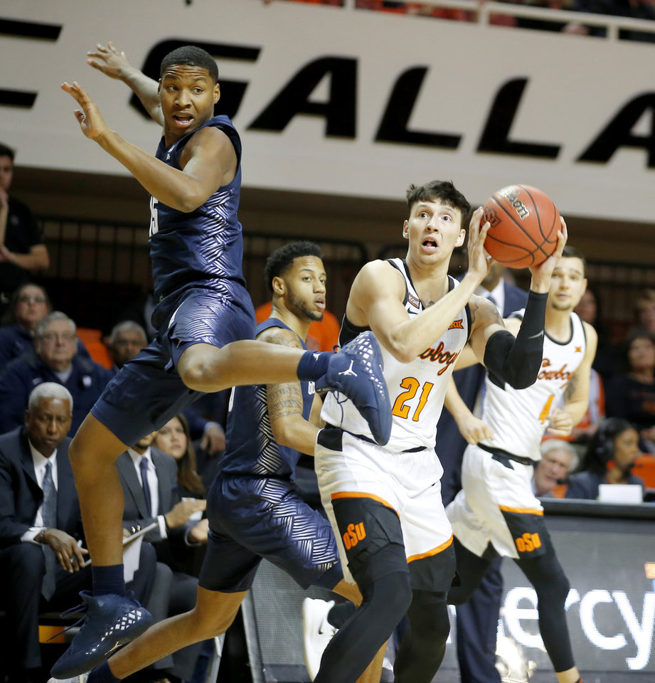 Photo - Oklahoma State's Lindy Waters III (21) attempts a shot beside Georgetown's Myron Gardner (15) during a college basketball game between the Oklahoma State University Cowboys (OSU) and the Georgetown Hoyas at Gallagher-Iba Arena in Stillwater, Okla., Wednesday, Dec. 4, 2019. [Bryan Terry/The Oklahoman]