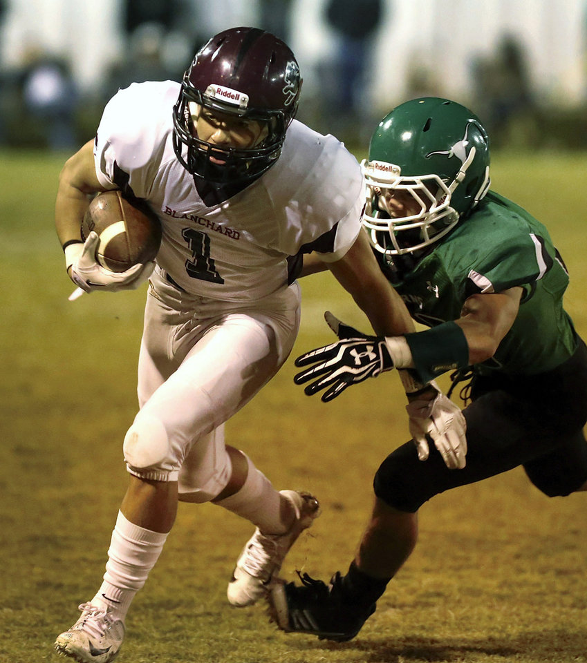 Photo - Blanchard's Kyle Self is chased down by a Jones tackler.  Blanchard vs. Jones high school football at Jones  High School on Friday, Oct. 12, 2012.   Photo by Jim Beckel, The Oklahoman