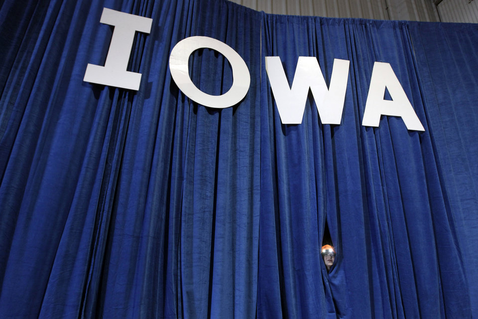 Republican vice presidential candidate, Rep. Paul Ryan's, R-Wis., son Sam peaks through a curtain during a campaign rally in Des Moines, Iowa, Monday, Nov. 5, 2012. (AP Photo/Mary Altaffer)