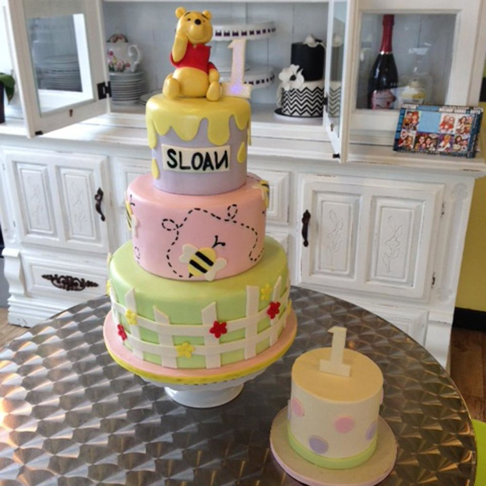 Photo - This undated photo provided by Tiffany Jones and posted in March 2014 to the Instagram account of her company, Peridot Sweets Las Vegas, shows a Winnie the Pooh birthday cake with coordinating smash cake. Jones says this cake had the most Instagram