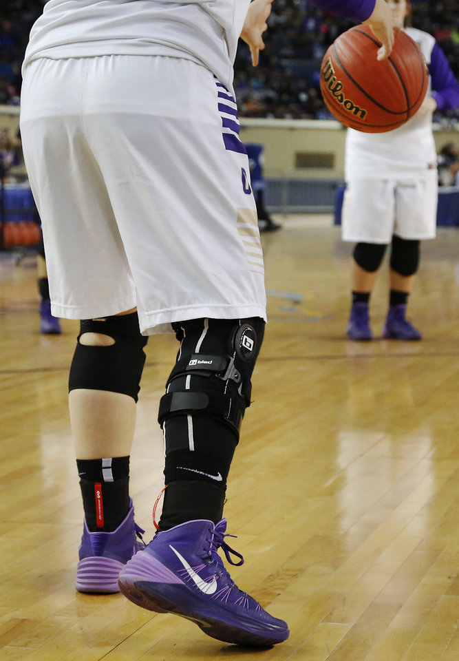 Photo - Okarche player Madison Lee played in the  Class B girls high school basketball championship game with a brace on her right leg.  Okarche defeated Red Oak, 66-41, in the Jim Norick Arena at State Fair Park on  Saturday, March 8, 2014.   Photo by Jim Beckel, The Oklahoman