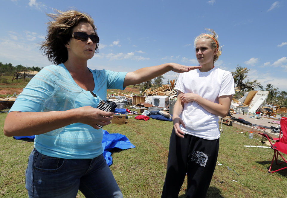 Brenda Church and daughter Cheyenne Wiley, 18, stand in front of the remains of their home on Thursday, May 23, 2013 in Little Axe, Okla.  The house was destroyed in Sunday's tornado in the Woodlands and Pecan Valley area.  Cheyenne lost all her clothes and her cap and gown for her graduation on Tuesday.   Photo by Steve Sisney, The Oklahoman