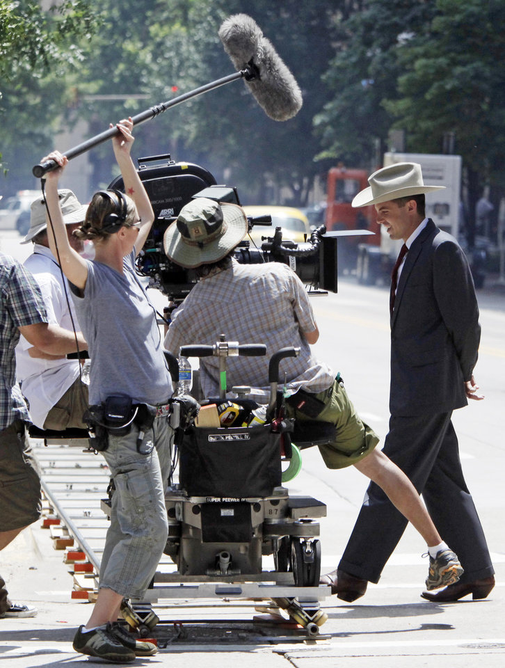 Photo - MOVIE: Casey Affleck, right, walks during a take on the set of the film