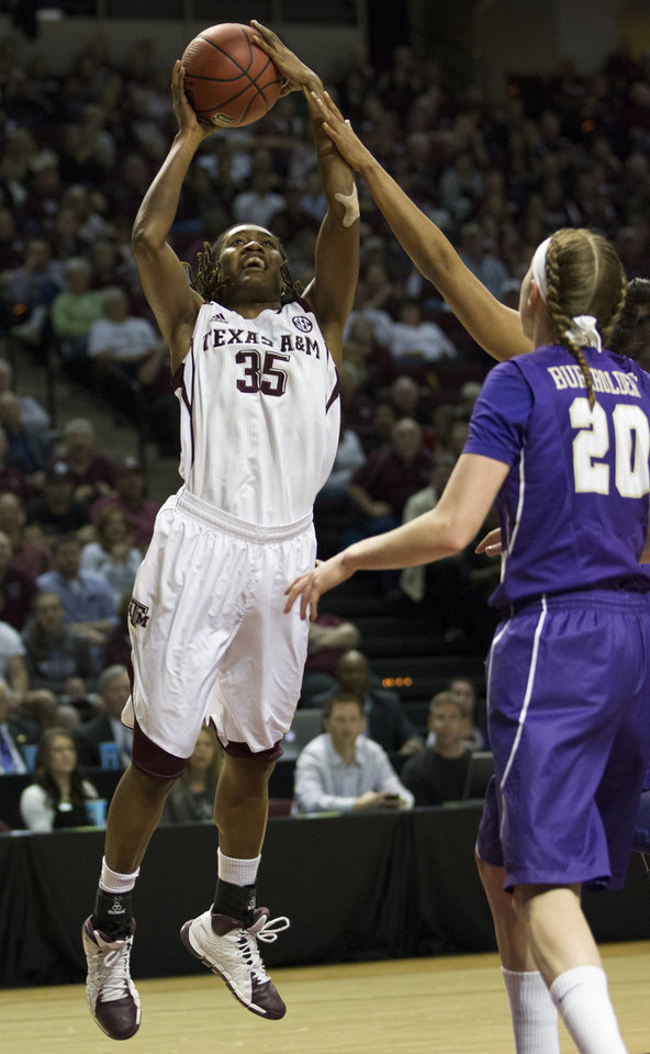 Photo - Texas A&M forward Achiri Ade (35) takes a shot during the first half of an NCAA women's basketball game against James Madison, Tuesday, March 25, 2014, in College Station, Texas. (AP Photo/Patric Schneider)