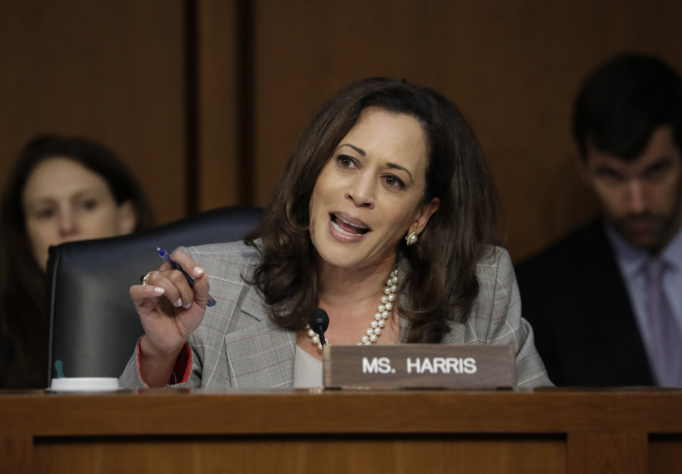 Photo - Sen. Kamala Harris, D-Calif., questions Attorney General Jeff Sessions testifies before the Senate Select Committee on Intelligence about his role in the firing of FBI Director James Comey and the investigation into contacts between Trump campaign associates and Russia, on Capitol Hill in Washington, Tuesday, June 13, 2017. (AP Photo/J. Scott Applewhite)