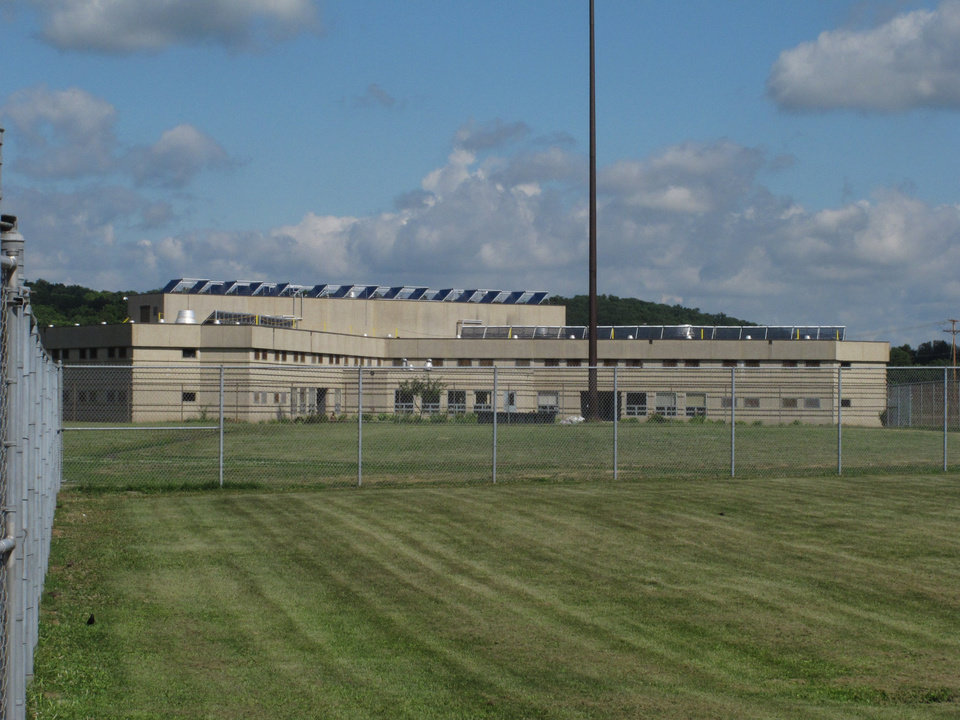Photo - Solar array panels atop a prison building at Ross Correctional Institution on Wednesday, July 16, 2014, in Chillicothe, Ohio. The Department of Rehabilitation and Correction says the panels on eight buildings will save about $245,000 in energy costs annually. (AP Photo/Andrew Welsh-Huggins)