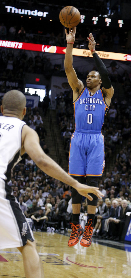 Photo - Oklahoma City's Russell Westbrook (0) shoots near San Antonio's Tony Parker (9) during Game 5 of the Western Conference Finals in the NBA playoffs between the Oklahoma City Thunder and the San Antonio Spurs at the AT&T Center in San Antonio, Thursday, May 29, 2014. Photo by Sarah Phipps, The Oklahoman