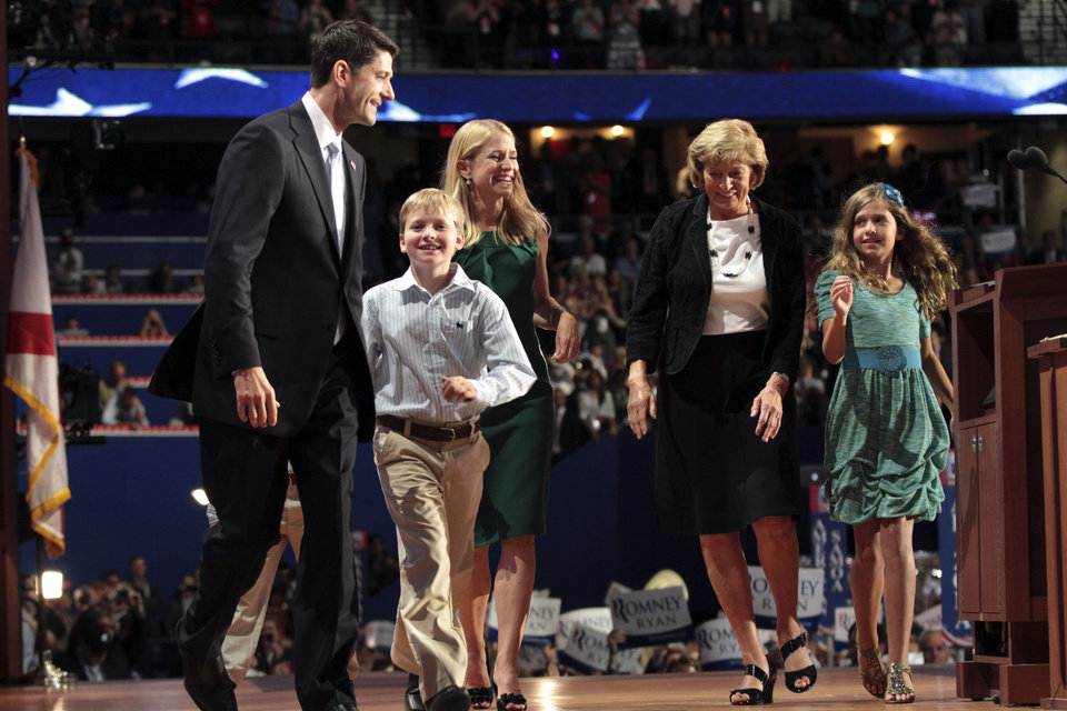 Photo -   Republican vice presidential candidate, Rep. Paul Ryan, R-Wis., is joined on stage by his wife Janna, mother Betty, daughter Liza, and son Charlie after addressing the Republican National Convention in Tampa, Fla., Wednesday, Aug. 29, 2012. (AP Photo/Mary Altaffer)