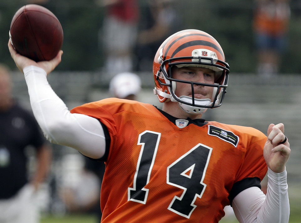 Photo - Cincinnati Bengals quarterback Andy Dalton passes during practice at the NFL football team's training camp on Wednesday, July 31, 2013, in Cincinnati.  (AP Photo/Al Behrman)