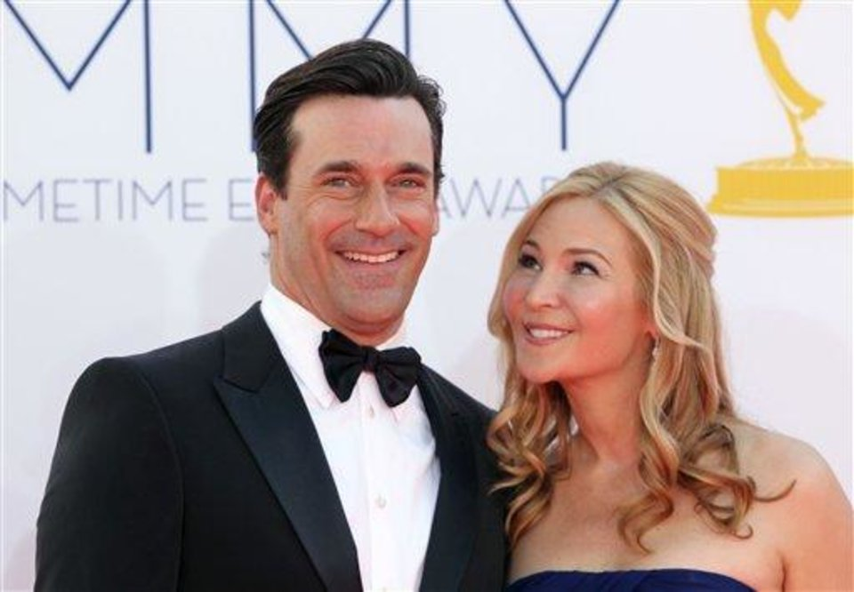Jon Hamm, left, and Jennifer Westfeldt arrive at the 64th Primetime Emmy Awards at the Nokia Theatre on Sunday, Sept. 23, 2012, in Los Angeles. (Photo by Matt Sayles/Invision/AP)