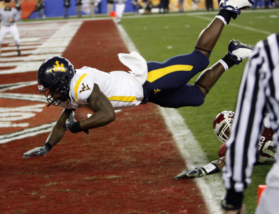 Photo - Wide receiver Darius Renaud dives into the end zone for a touchdown during the second half of the Fiesta Bowl college football game between the University of Oklahoma Sooners (OU) and the West Virginia University Mountaineers (WVU) at The University of Phoenix Stadium on Wednesday, Jan. 2, 2008, in Glendale, Ariz. 