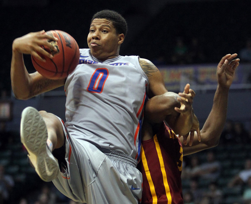 Photo - Boise State forward Ryan Watkins, left, fights for a rebound with Iowa State's Melvin Ejim during an CAA college basketball game at the Diamond Head Classic, Wednesday, Dec 25, 2013, in Honolulu. (AP Photo/The Idaho Statesman, Darin Oswald) LOCAL TV OUT (KTVB 7)