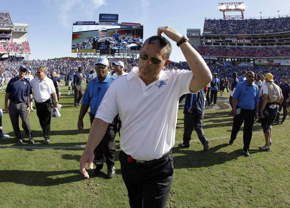 Photo -   Detroit Lions head coach Jim Schwartz leaves the field after the Lions lost to the Tennessee Titans 44-41 in overtime at an NFL football game on Sunday, Sept. 23, 2012, in Nashville, Tenn. (AP Photo/Wade Payne)