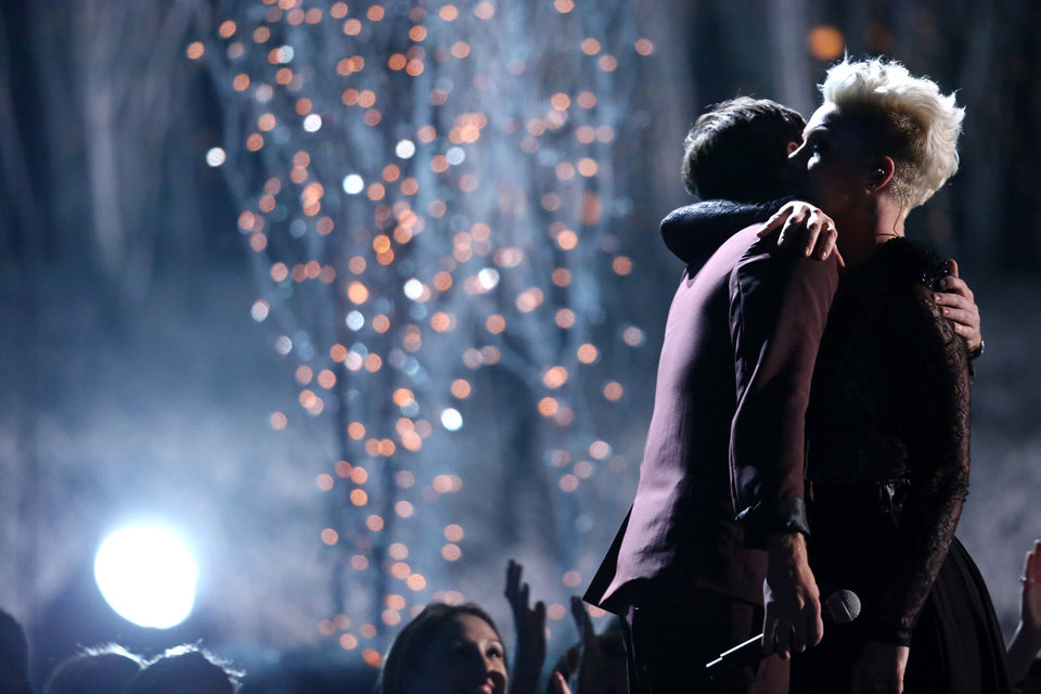 """Photo - Nate Ruess, left, and Pink embrace after performing """"Just Give Me a Reason"""" at the 56th annual Grammy Awards at Staples Center on Sunday, Jan. 26, 2014, in Los Angeles. (Photo by Matt Sayles/Invision/AP)"""