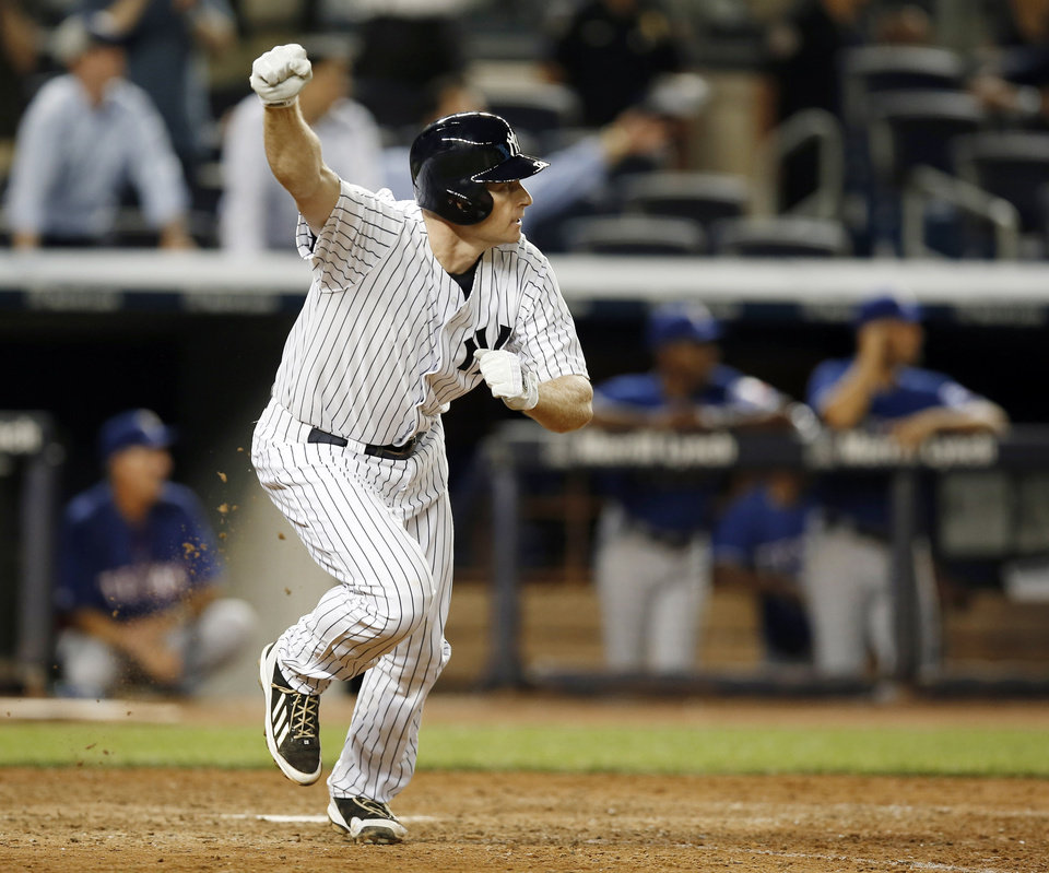 Photo - New York Yankees Chase Headley celebrates after hitting a 14th-inning walk-off RBI single in the Yankees 2-1 victory over the Texas Rangers in a baseball game at Yankee Stadium in New York, Wednesday, July 23, 2014.  (AP Photo)