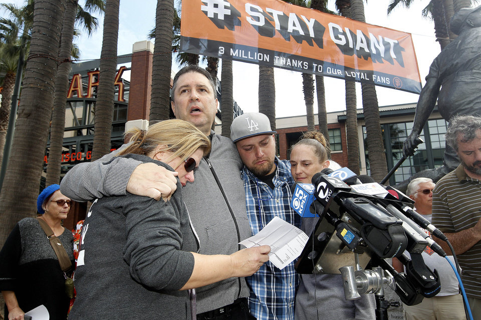 From left to right, Jill Haro, aunt, Robert Preece, father, and Robert Preece Jr., brother, and Diana Denver, mother, of Los Angeles Dodgers fan Jonathan Denver, make a public plea for witnesses to the fatal stabbing Wednesday of Jonathan Denver, Sunday, Sept. 29, 2013, outside the stadium before the Giants' baseball game Sunday in San Francisco. Jonathan Denver, 24, was stabbed Wednesday during a melee following a game between the Giants and the Los Angeles Dodgers. (AP Photo/Tony Avelar)