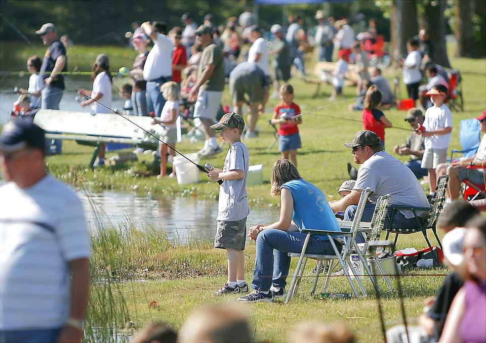 Photo - The shore at Ten Acre Lake in Choctaw is lined with people during the Kids' All American Fishing Derby.  PHOTOS BY BRYAN TERRY, THE OKLAHOMAN