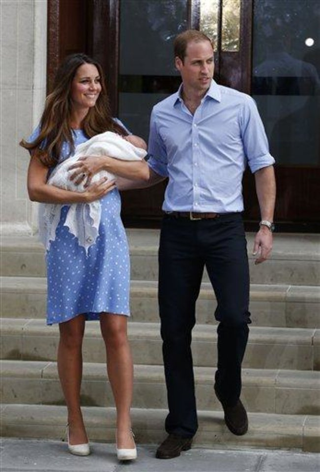 Photo - Prince William and Kate, the Duchess of Cambridge, carry their new baby outside St. Mary's Hospital. (AP Photo/Lefteris Pitarakis)
