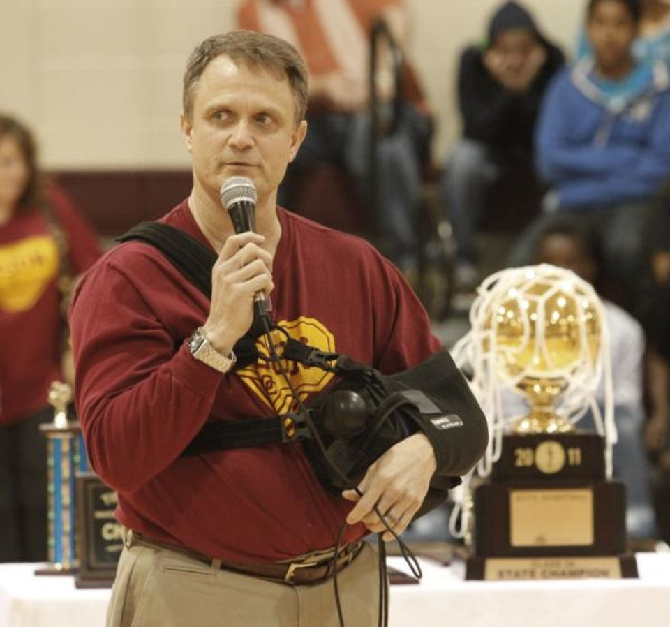 HIGH SCHOOL BASKETBALL / STATE CHAMPIONSHIP / CELEBRATE / CELEBRATION: Coach Scott Raper talks to students during an assembly celebrating the Centennial boys state basketball championship in Oklahoma City , March 25 , 2011. Photo by Steve Gooch, The Oklahoman <strong>Steve Gooch</strong>