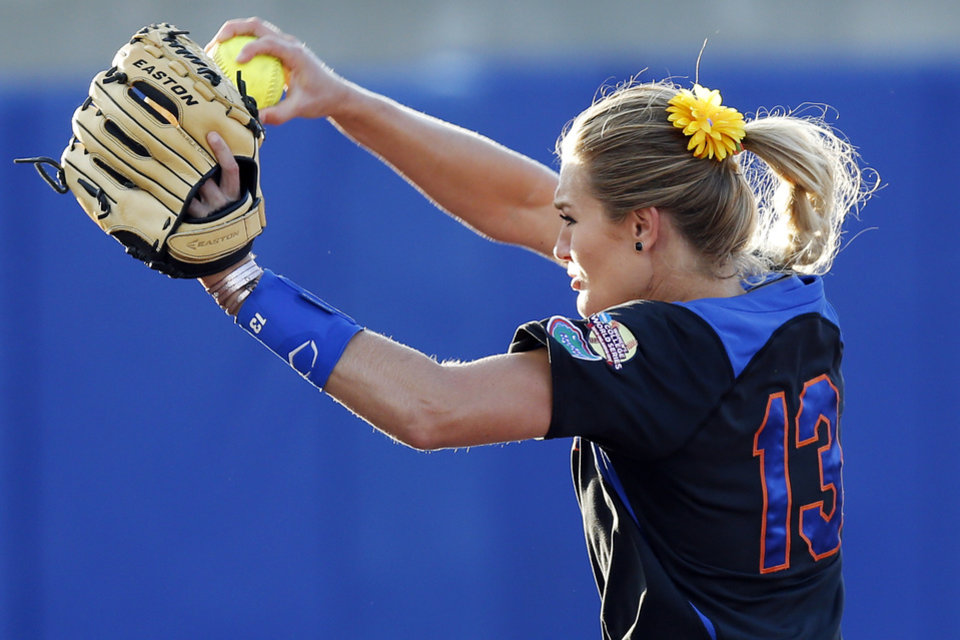 Photo - Florida's Hannah Rogers (13) pitches during Game 5 of the Women's College World Series softball tournament between Florida and Oregon at ASA Hall of Fame Stadium in Oklahoma City, Friday, May 30, 2014. Photo by Nate Billings, The Oklahoman