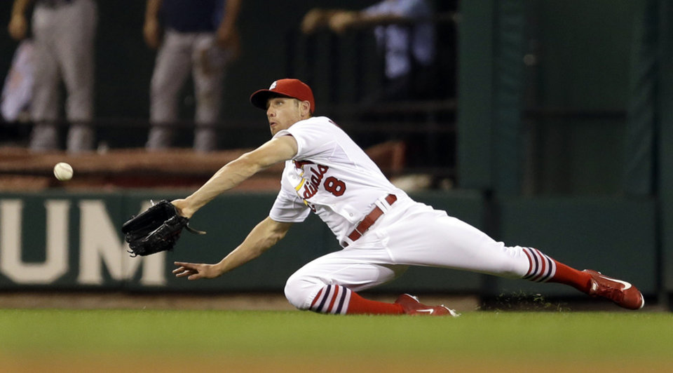 Photo - St. Louis Cardinals center fielder Peter Bourjos dives and catches a ball hit by Tampa Bay Rays' Desmond Jennings for an out to end the top of the eighth inning of a baseball game Tuesday, July 22, 2014, in St. Louis. (AP Photo/Jeff Roberson)
