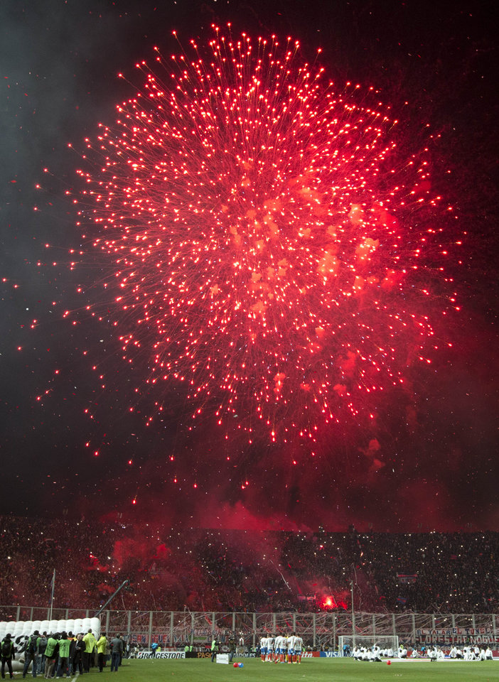 Photo - Fireworks explode at the start of a Copa Libertadores final soccer match between Argentina's San Lorenzo and Paraguay's Nacional in Buenos Aires, Argentina, Wednesday, Aug. 13, 2014. (AP Photo/Victor R. Caivano)