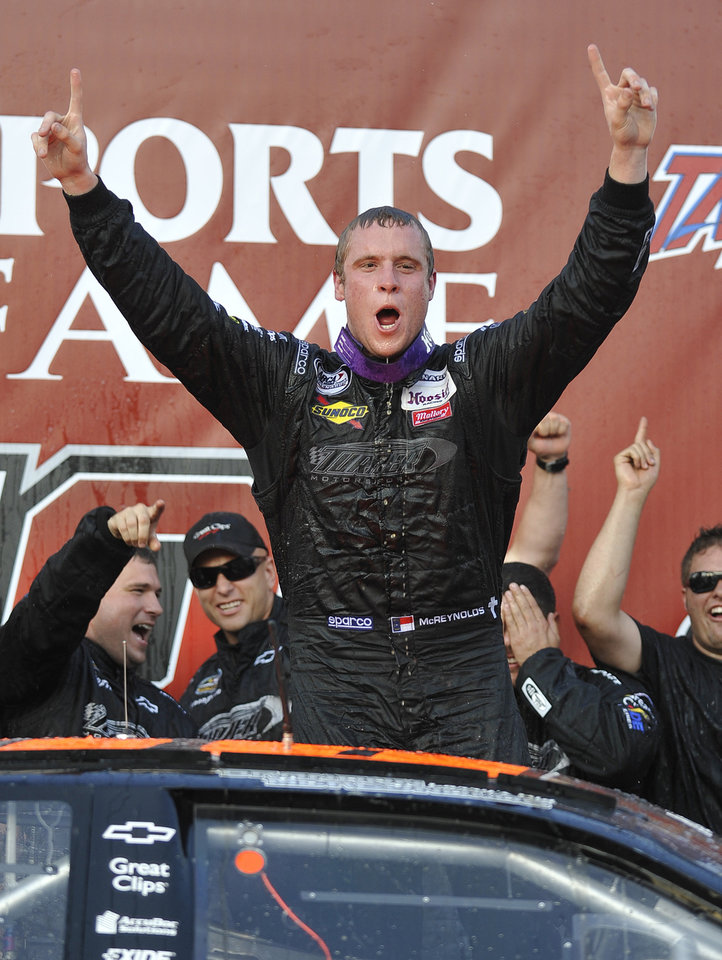 Photo -   Brandon McReynolds celebrates after winning the International Motorsports Hall of Fame 250 ARCA auto race at Talladega Superspeedway in Talladega, Ala., Friday, May 4, 2012. (AP Photo/Rainier Ehrhardt)