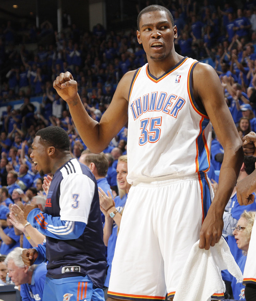 Oklahoma City's Kevin Durant (35) reacts after a three point shot by Oklahoma City's Eric Maynor (6) during game two of the Western Conference semifinals between the Memphis Grizzlies and the Oklahoma City Thunder in the NBA basketball playoffs at Oklahoma City Arena in Oklahoma City, Tuesday, May 3, 2011. Photo by Chris Landsberger, The Oklahoman