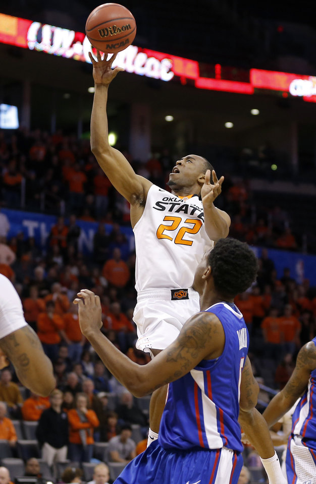Photo - Oklahoma State's Markel Brown (22)  shoots over Louisina Tech's Alex Hamilton during the All-College Classic basketball game between Oklahoma State University and Louisiana Tech at Chesapeake Energy Arena in Oklahoma City, Okla., Saturday, Dec. 14, 2013. Photo by Bryan Terry, The Oklahoman