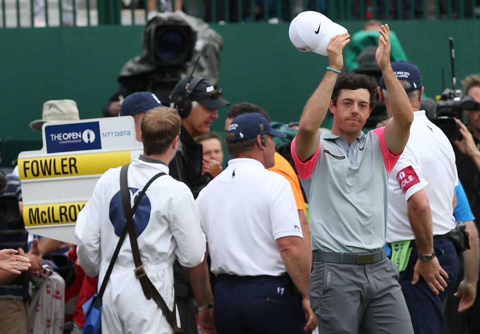 Photo - Rory McIlroy of Northern Ireland waves to the crowd as he celebrates winning the British Open Golf championship at the Royal Liverpool golf club, Hoylake, England, Sunday July 20, 2014. (AP Photo/Scott Heppell)