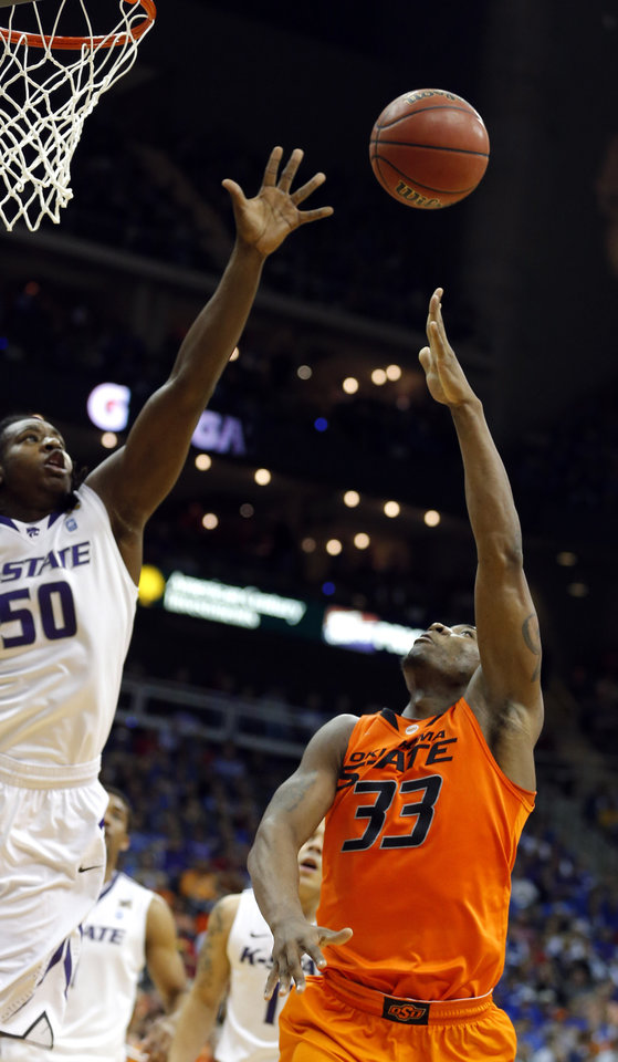 Oklahoma State\'s Marcus Smart (33) shoots over Kansas State\'s D.J. Johnson during the Phillips 66 Big 12 Men\'s basketball championship tournament game between Oklahoma State University and Kansas State at the Sprint Center in Kansas City,Friday, March 15, 2013. Photo by Sarah Phipps, The Oklahoman