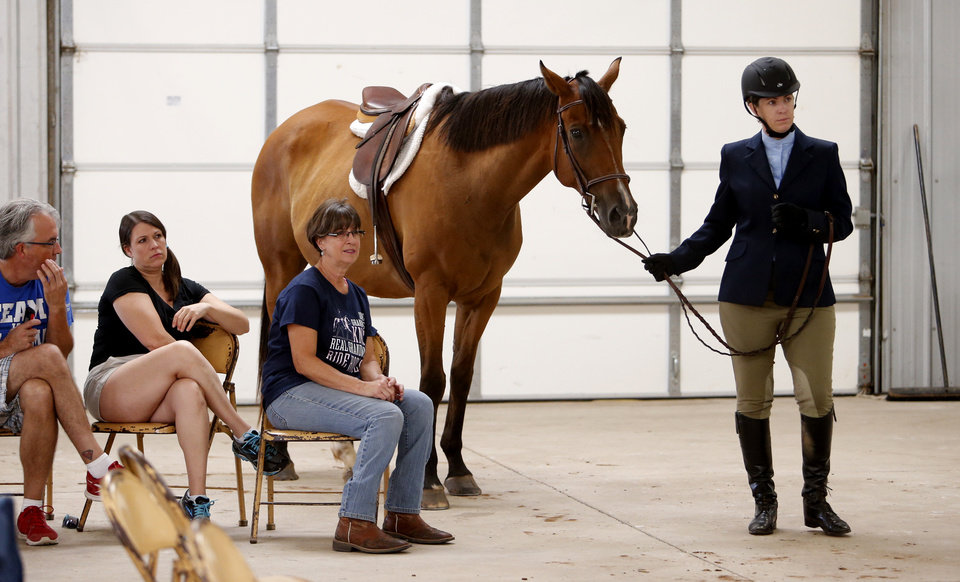 Photo -  Leah Branning waits to ride Max in the Working Hunter Class during the Cleveland County Free Fair Horse Show. PHOTO BY STEVE SISNEY, THE OKLAHOMAN   STEVE SISNEY -